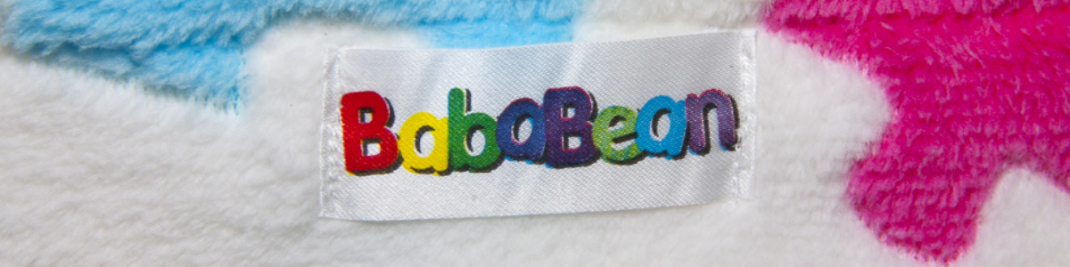 Bababean trademark logo label on jacquered stroller blanket