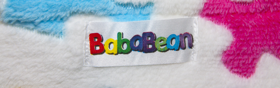 Bababean trademark logo label on jacquered stroller blanket